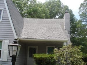 """SoftWash Low Pressure Roof Cleaning Don't replace your roof — restore it instead! Clean County provides professional roof cleaning services that protect the long life, curb appeal, and quality of your shingles. A Solution For Black Stains If you live in the Tri State area, it's likely that you've run into the """"black stain"""" issue on roofs. Many homes in the area have dark striped running down their shingles. The responsible party? A type of bacteria called Gloeocapsa Magma, which looks like algae and feeds on the limestone in your shingles. When Gloeocapsa Magma takes hold, it eats away at your roofing. This introduces issues like:"""