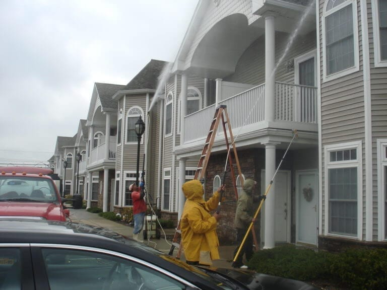 "Your property deserves an exterior cleaning ally - and we're here to fill those shoes! Clean County proudly serves HOAs, condos, and multi-unit properties in the area with comprehensive exterior cleaning solutions. Complete Exterior Cleaning Services Managing a property is a big job - and we're here to make it that much easier. With our one-stop-shop solutions, you can count on the best quality in: townhouse power washing new york Building Washing We have capability for power washing and soft washing, which allows us to bring the best clean to any exterior surface. We remove stains, buildup, and mold and mildew from virtually every material, including: Vinyl Brick Stucco Wood Cedar The Area's Top Provider Of Quality Parking Garage Cleaning & Maintenance Services. Parking Garages should be cleaned in the Northeast at least once a year, and in high traffic garages twice a year, due to the salts and other contaminants that get into the garage surfaces. They eventually get absorbed into the concrete parking surfaces and soon will cause the rebar to rot out. When this happens the concrete begins to leak,crack and in the worse case scenario the garage itself can be condemned. We use state of the art hot and cold water powerwashing machines ranging up to 4000 PSI with up to 200+ degree water, surface machines and any cleaning solutions needed for all parking garage cleaning. Our knowledgeable staff is experienced on how to lighten or when possible remove stains completely. Each Parking Garage cleaning is approached based upon the existing conditions, and we will use the correct products and methods specific to your facility's cleaning and maintenance requirements. Concrete Cleaning Our hot water power washing solution is the most effective way to give your property a facelift. We remove chewing gum, stains, dirt, and other imperfections from your: Parking Lot Sidewalk Patio Entryway Driveway house pressure washing new york Roof Cleaning A clean roof completes your property's curb appeal - but it also increases the lifetime of your shingles. Our soft wash solution gets the job done. Our roof cleaning service comes with these benefits: Safe For Asphalt Shingles Won't Void Your Warranty Removes Harmful Algae Restores Roof Curb Appeal SoftWash Low Pressure Roof Cleaning Don't replace your roof — restore it instead! Clean County provides professional roof cleaning services that protect the long life, curb appeal, and quality of your shingles. A Solution For Black Stains If you live in the Tri State area, it's likely that you've run into the ""black stain"" issue on roofs. Many homes in the area have dark striped running down their shingles. The responsible party? A type of bacteria called Gloeocapsa Magma, which looks like algae and feeds on the limestone in your shingles. Gutter Cleaning Removing the debris from your gutters is extremely important. Leaves, dirt and other debris can cause standing water to damage your property. Our gutter cleaning service includes: Removing Debris Washing Out Downspouts Flushing Downspouts Optional Gutter Face Brightening"